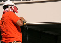 man working on siding
